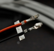 Supply wires with contacts crimped