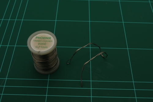 Bend wire into a small stand