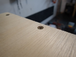 Wood screw fitting perfectly in the countersunk hole.